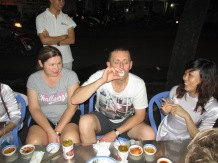Lisa struggling with my Balut! XO Tour.