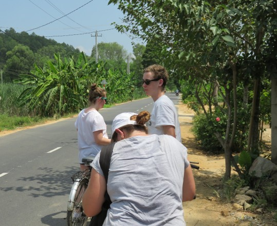 about 30 degrees, kids no hats. Riding back to Hue